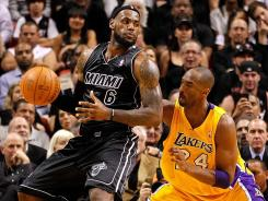 LeBron James (6) had 31 points, eight assists and eight rebounds to lead the Heat past the Lakers and Kobe Bryant, who finished with 24 points, seven assists and five rebounds.