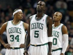 With the Boston Celtics' off to a 5-8 start, GM Danny Ainge must consider breaking up the Big Three of Paul Pierce, left, Kevin Garnett, center, and Ray Allen, right