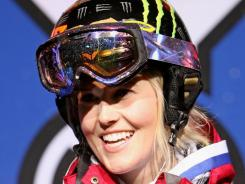Sarah Burke of Whistler, Canada, celebrates as she takes the podium after winning the gold medal in the women's skiing superpipe at Winter X Games 13, Jan. 23, 2009, in Aspen, Colo.