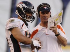Broncos OC Mike McCoy, right, helped QB Tim Tebow be effective in 2011.