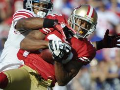 Carlos Rogers, front, picked off Giants quarterback Eli Manning twice in the 49ers' 27-20 win in Week 10.