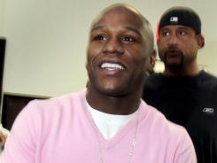 Floyd Mayweather donated $100,000 to the Susan J. Komen breast cancer charity on Thursday, making good on a promise to the Las Vegas judge who sentenced him to 87 days in jail.