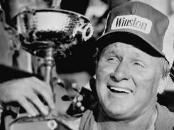 Driver Cale Yarborough is shown in 1978 after winning the American 500 at the North Carolina Motor Speedway in Rockingham.