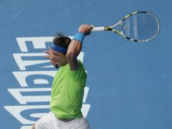 No. 2 Rafael Nadal of Spain wallops a forehand in his victory against Lukas Lacko of Slovania.