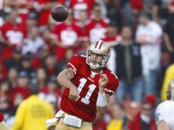 49ers quarterback Alex Smith set career highs in most passing categories in 2011 and had a 28-yard touchdown run Saturday to beat the Saints.