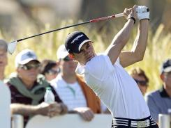 Camilo Villegas launches his tee shot on the ninth hole of the Jack Nicklaus Private Course at PGA West during the first round of the Humana Challenge on Thursday in La Quinta, Calif.