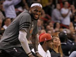 Miami Heat forward LeBron James will play through flu-like symptoms to face the Los Angeles Lakers today.