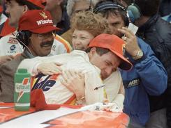 Darrell Waltrip hugs his wife, Stevie, after winning the 1989 Daytona 500 -- the 74th win of his illustrious 84-win career. The three-time Cup champion will be inducted into NASCAR's Hall of Fame this weekend.