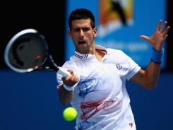 Serbia's Novak Djokovic during his straight-set victory over France's Nicholas Mahut on Saturday in Melbourne, Australia. Djokovic needed just 74 minutes to win and move on.