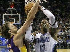 Dwight Howard's 21 points and 23 rebounds helped the Magic drop the Lakers to 1-6 on the road.