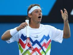 David Nalbandian of Argentina shows his frustration with the umpire during his second-round match against John Isner.