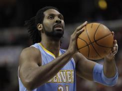 The Nuggets' Nene  may not be available for Saturday's at the Knicks because of a bruised right heel.