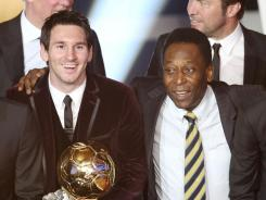Argentina's Lionel Messi and Brazil's soccer legend Pele stand together after Messi was awarded the prize for the soccer player of the year for 2011 at the FIFA Ballon d'Or ceremony on Jan. 9.