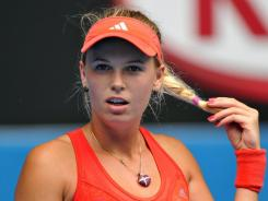 Caroline Wozniacki of Denmark, who is into Round 4 of the Australian Open, shows off her Christmas gift from boyfriend Rory McIlroy.