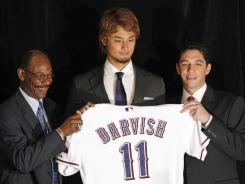 Two days after agreeing to a six-year, $60 million contract, Japanese pitcher Yu Darvish was officially introduced by the Texas Rangers.