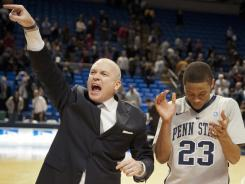 Penn State coach Patrick Chambers, left,  and guard Tim Frazier celebrate the team's 54-52 victory over Illinois in State College, Pa. on Thursday. Frazier finished  with 12 points and nine assists in the game.
