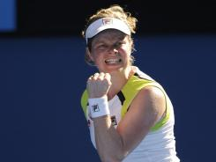 Defending champion Kim Clijsters fought off an ankle injury and four match points on her way to a fourth-round victory against reacts Li Na of China.