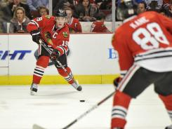 Patrick Kane, foreground, was involved in all of Chicago's three goals Friday, scoring two goals and assisting Jonathan Toews, rear, in the other. The Blackhawks picked up a 3-1 win.