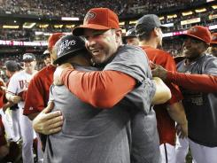 Diamondbacks manager Kirk Gibson hugs Gerardo Parra after clinching the NL West title on Sept. 23. It's a scene Arizona would like to repeat in 2012.