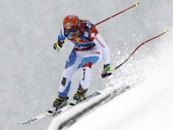 Didier Cuche carves up the course on his way to winning Saturday's World Cup downhill in Kitzbuehel, Austria.
