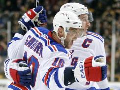 The Rangers' Marian Gaborik (10) celebrates his game-winning goal in overtime with teammate Ryan Callahan.