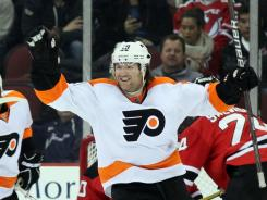 Flyers left wing Scott Hartnell celebrates Philly's second goal against the New Jersey Devils during the second period.