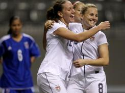 Amy Rodriguez (8) celebrates her goal with teammate Lauren Cheney (12) during the second half of Team USA's CONCACAF women's Olympic qualifying soccer  match at B.C. Place in Vancouver on Friday.
