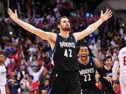 Kevin Love celebrates his game-winning 3-pointer that lifted Minnesota to its fourth win in five games.
