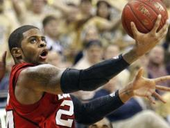 Louisville's Chane Behanan (24) scores in the second half in Pittsburgh.