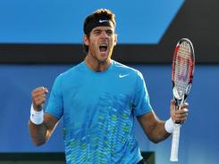Juan Martin del Potro of Argentina celebrates on match point after knocking off Philipp Kohlschreiber of Germany in the fourth round,
