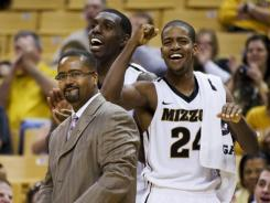 Missouri head coach Frank Haith, left, celebrating with Kim English, right, and Ricardo Ratliffe, back, has the Tigers at No. 2 in the nation.