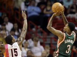 Bucks guard Brandon Jennings, right, was just 5-for-20 from the field for 23 points, but Milwaukee managed to beat the Heat in Miami on Sunday despite a poor game offensively.