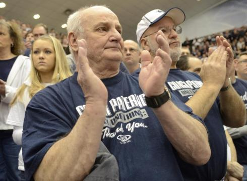 Penn State wrestling fans Gary Reed, left, of Huntingdon, Pa., and