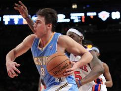 Denver forward Danilo Gallinari drives past New York's Bill Walker on Saturday night. Gallinari scored a career-high 37 points in the Nuggets' win.