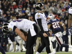 Baltimore Ravens kicker Billy Cundiff watches his field goal attempt sail wide during the AFC Championship Game.
