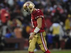 """Quarterback Alex Smith, who had his best season as a pro, headlines a long list of 49ers free agents. """"No question, (I) would love to stay here,"""" he says."""