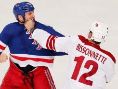 Phoenix Coyotes left wing Paul Bissonnette, right, says he worries about stress stemming from his tough guy position.