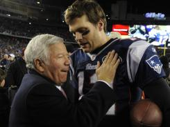 Patriots quarterback Tom Brady talks to team owner Robert Kraft on Sunday after going 22-for-36 for 239 yards with no touchdowns and two interceptions against the Ravens in the AFC Championship Game. Brady apologized to Kraft for his performance and vowed to play better Feb. 5 in Super Bowl XLVI.