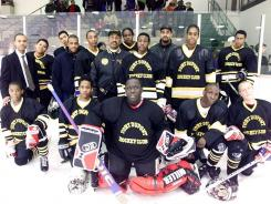 Fort Dupont Cannons hockey team with coach Neal Henderson, center in jacket.