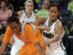 Notre Dame guard Skylar Diggins, right, and Tennessee guard Ariel Massengale battle for a loose ball in the second half in South Bend, Ind.