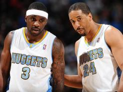 Ty Lawson (3) and Andre Miller (24) are co-existing in the Denver backcourt and helping the Nuggets lead the NBA in assists.