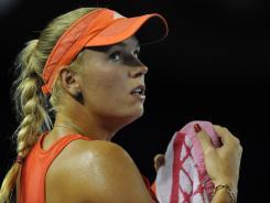 Caroline Wozniacki of Denmark will face Kim Clijsters in the Australian Open quarterfinals.