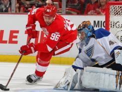 The Red Wings' Tomas Holmstrom (96) shoots against Blues goalie Jaroslav Halak during the first period at the Joe Louis Arena in Detroit.