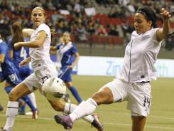 Sydney Leroux, right, and Team USA were dominant in their 13-0 win vs. Guatemala on Sunday.