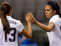 Sydney Leroux (right) and Alex Morgan celebrate Leroux's goal against Guatemala during the second half in a CONCACAF women's Olympic qualifying soccer game in Vancouver, British Columbia, on Sunday.
