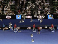 A flock of seagulls fly over Rod Laver Arena during the fourth round match between Novak Djokovic of Serbia and Lleyton Hewitt of Australia.