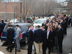 Friends and family wait outside of the Pasquerilla Spritual Center for one of two public viewings for the passing of former Penn State coach Joe Paterno.