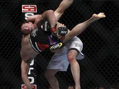 Chael Sonnen, facing camera, used his wrestling and submission skills to overwhelm Brian Stann during their October 2011 fight at UFC 136 in Houston.