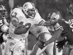 One shot:  Dan Marino, then a second-year player, tries to elude the 49ers defense in Super Bowl XIX, which was won 38-16 by San Francisco and Joe