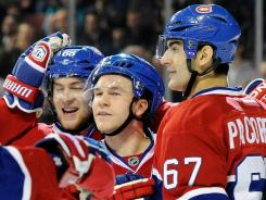 Montreal's David Desharnais, center, celebrates his second period goal against the Detroit Red Wings at the Bell Centre.